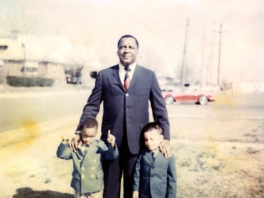 Childhood photo shows Martin Perry, right, posing with his brother and father.