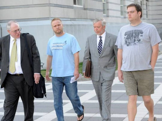 David Nicoll of Mountain Lakes (blue shirt), president of Biodiagnostic Laboratory Services, and brother Scott Nicoll of Wayne (gray shirt) leave Federal Court in Newark after a 2013 appearance.