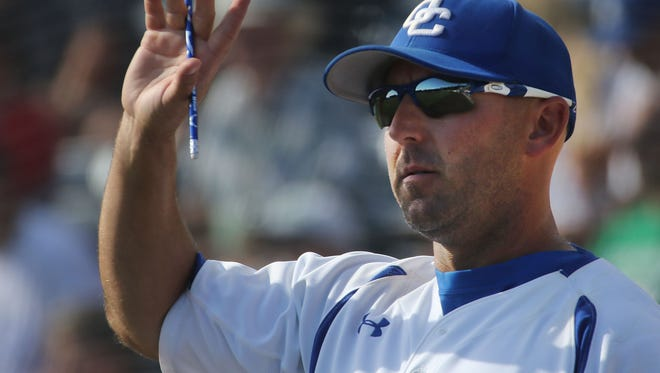 Oak Creek varsity baseball coach Scott Holler watches his team in 2016. Holler is the only athletics director in the Now coverage area in a big-school conference who also serves as head coach of a varsity sport.