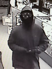 Burlington police released this surveillance photo of the person who robbed the Northern Lights store on Main Street on Tuesday, Dec. 13, 2016.