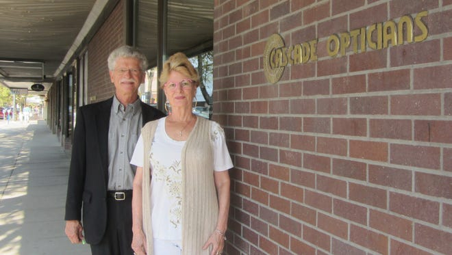 Dr. Gerald Meguire, left, and Connie Ray have worked together at Cascade Opticians for more than 30 years. The business closes Aug. 31.