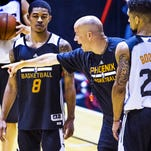 Tyler Ulis, left, and Askia Booker, right, get instruction from Suns Summer League head coach Nate Bjorkgren during practice at Talking Stick Resort Arena in Phoenix, on Friday, July 8, 2016.