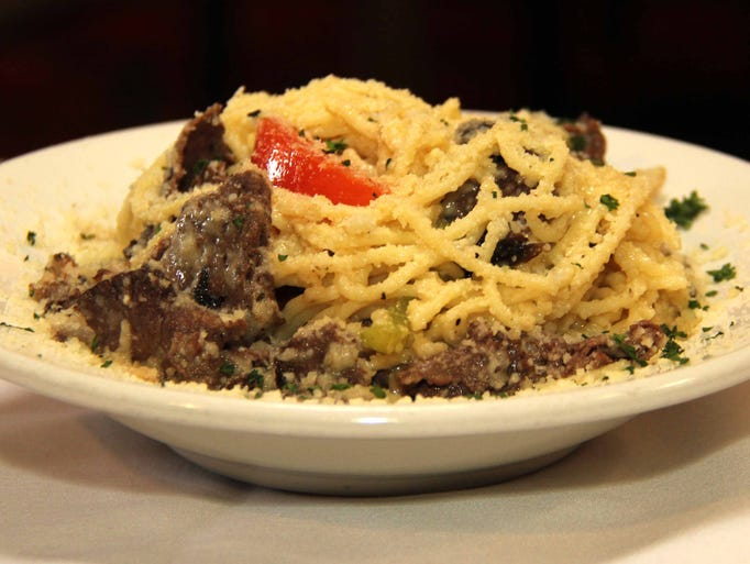 Beef marinated in the house salad dressing along with vermicelli tossed in butter and parmesan makes Verona beef stand out.