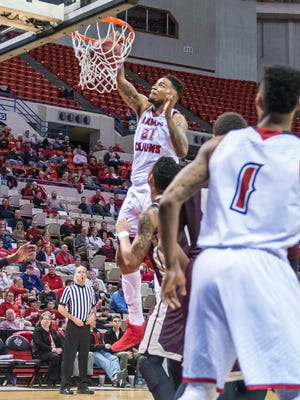 Ragin' Cajuns forward Shawn Long (21) dunks in UL's home win over Texas State in January.