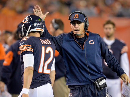 Chicago Bears head coach Marc Trestman congratulates quarterback David Fales (12) after a 32-yard touchdown pass against the Cleveland Browns in the second quarter of a preseason NFL football game Thursday, Aug. 28, 2014, in Cleveland. (AP Photo/David Richard)