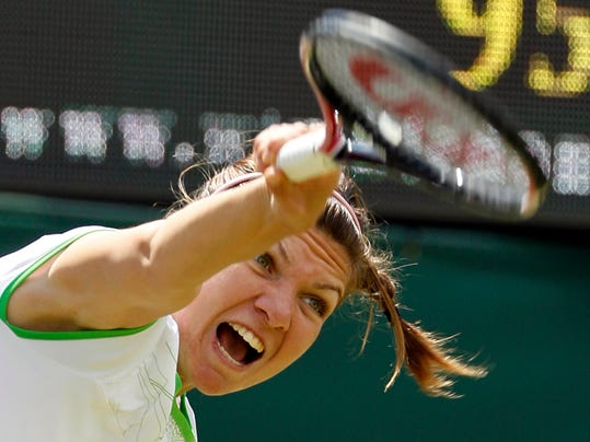 ADVANCE FOR WEEKEND EDITIONS, JUNE 21-22 - FILE - In this June 23, 2011, file photo, Romania's Simona Halep serves to Serena Williams, of the United States, during their match at the All England Lawn Tennis Championships at Wimbledon.. (AP Photo/Alastair Grant, File)