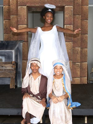 """Cast members of Youth Repertory Theater Troupe's production of Langston Hughes' """"Black Nativity"""" at the Louisville Central Community Center."""