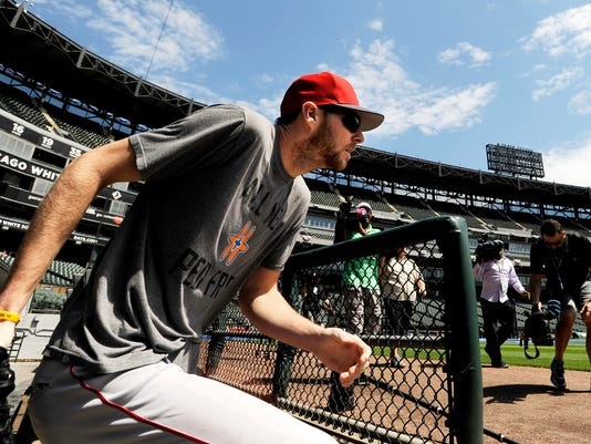 Boston Red Sox pitcher Chris Sale walks onto the field at Guaranteed Rate Field before a baseball game against the Chicago White Sox, Monday, May 29, 2017, in Chicago. (AP Photo/Paul Beaty)