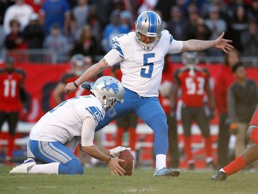 Detroit Lions kicker Matt Prater (5) kicks the game