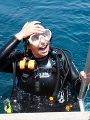 """Patricia Wuest, editor of Sport Diver and Scuba Diving magazines, returns to the deck of the H20 Below after a dive on the San Pablo, also known as the """"Russian Freighter,"""" in the Gulf of Mexico in 2014."""