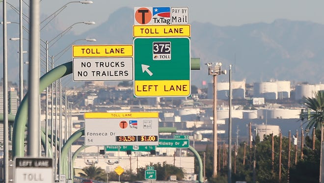In this October 2015 file photo, vehicles head west on the César Chávez Border Highway, including its toll lane.