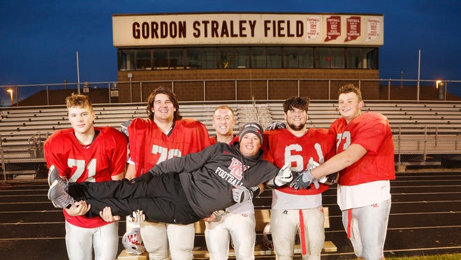 West Lafayette head coach Shane Fry with the Red Devils offensive line. With Fry are Aidan Sturgeon, from left, sophomore, 205 lbs., Sabastrian Trent, senior, 298 lbs., August Schott, senior, 225 lbs., Seif Benjemia, junior, 300 lbs., and Tommy Kirschbaum, senior, 303 lbs.