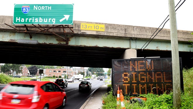 A sign along East Market Street near I-83 warn of signal timing changes on that section of road Monday, July 30, 2018. Left turn arrows in the area now cycle yellow, allowing traffic to turn left when oncoming traffic is clear. Bill Kalina photo