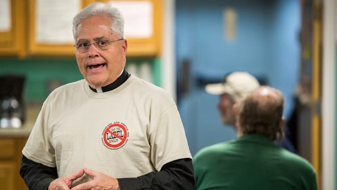 The Rev. Paul Mast speaks to homeless men at Andrew's Place in Wilmington on Oct. 6, one of the shelters he stayed in during a six-month sabbatical.