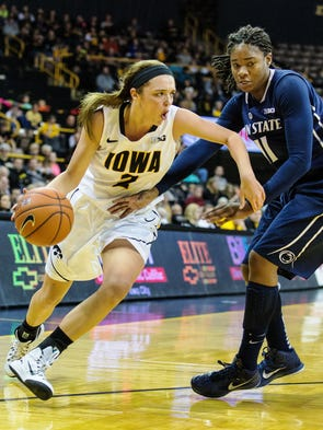 Iowa's Aly Disterhoft (2) drives to the basket against