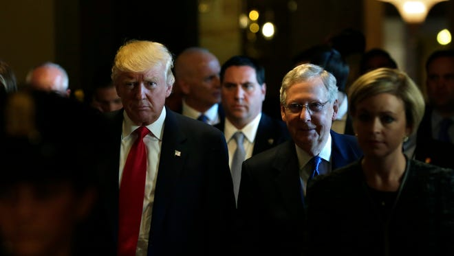 US President-elect Donald Trump walks with Senate Majority Leader Mitch McConnell (R) at the Capitol in Washington, DC, on November 10, 2016. / AFP / YURI GRIPAS        (Photo credit should read YURI GRIPAS/AFP/Getty Images)