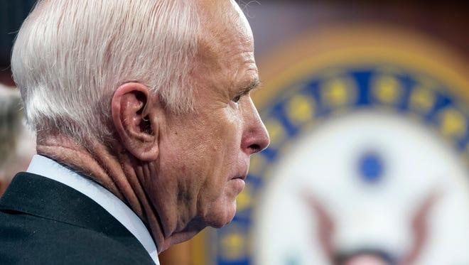 Sen. John McCain, R-Ariz., speaks to reporters on July 27, 2017.