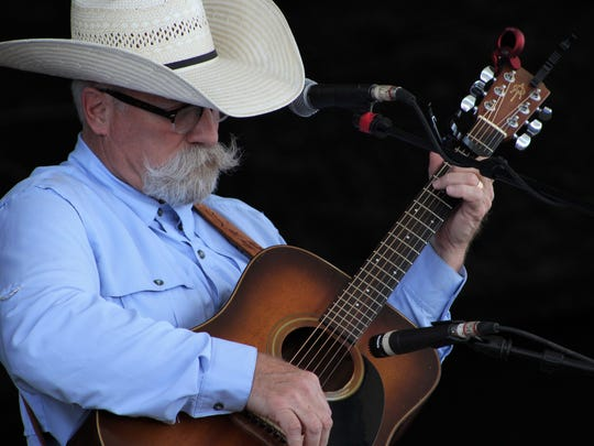 Jeff Gore, famous for his western-style mustache and beard, performs Friday at the pavilion at the Taylor County Expo Center. He and his wife, Donna, have been at the Western Heritage Classic the past 15 years.