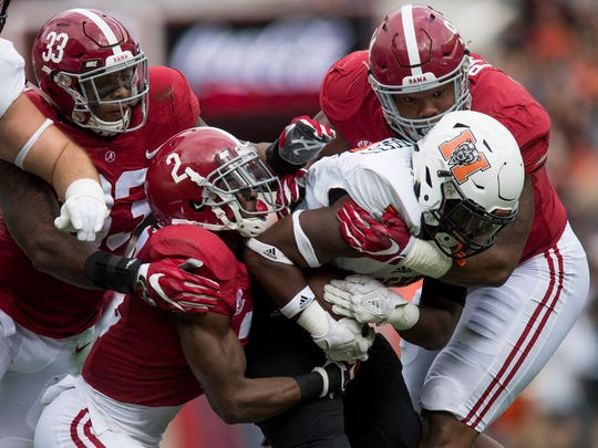 Alabama defensive back Tony Brown (2), linebacker Anfernee