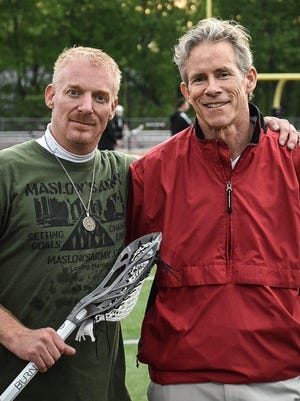 Sam Landis joins Chris Johnstone of Milford lacrosse May 9 as Landis was made honorary captain.
