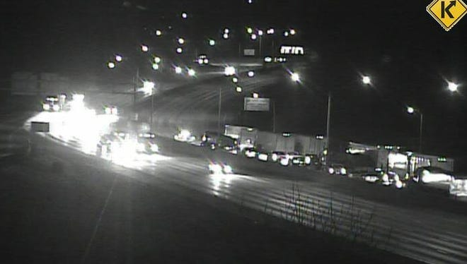 Vehicles are stopped on NB I-71/75 at Kyles Lane shortly after 5 a.m. Thursday. The road was closed as police investigated a crash where a pedestrian was struck and killed.