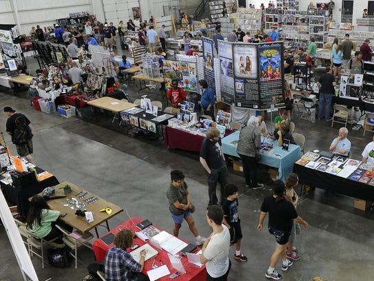 Comic fans meander through the Comic City event at