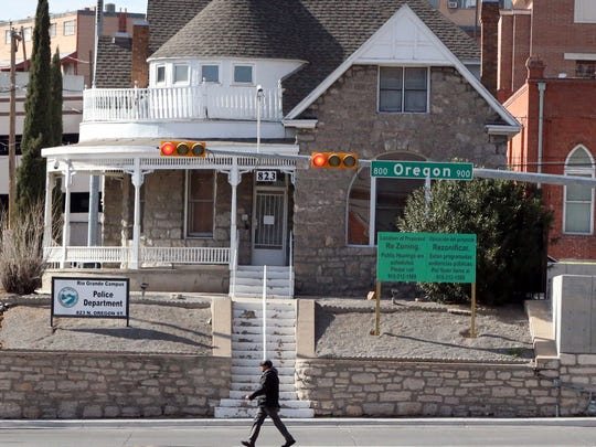 A rezoning sign sits outside the Queen Anne-style home along the 900 block of North Oregon Street and Montana Avenue near Downtown El Paso. The building won't be affected by the new El Paso Community College Rio Grande Campus facility, officials said.
