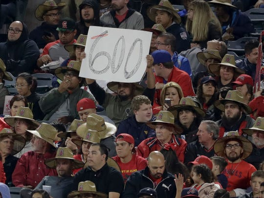 A fan holds up a sign as Albert Pujols off the Angels came to bat during the fourth inning of a game against the Braves on Wednesday/