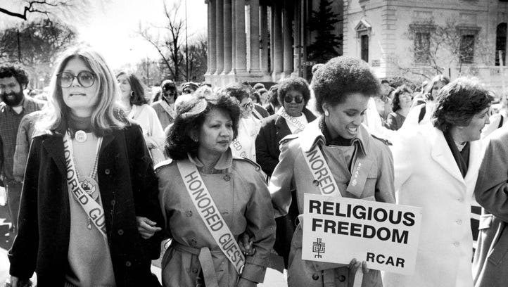Gloria Steinem, left, and other women march in Washington