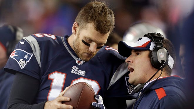 """FILE - In this Nov. 3, 2013, file photo, New England Patriots offensive coordinator Josh McDaniels, right, talks to quarterback Tom Brady during the fourth quarter of an NFL football game against the Pittsburgh Steelers in Foxborough, Mass. A federal appeals court has ruled, Monday, April 25, 2016,  that New England Patriots Tom Brady must serve a four-game """"Deflategate"""" suspension imposed by the NFL, overturning a lower judge and siding with the league in a battle with the players union."""
