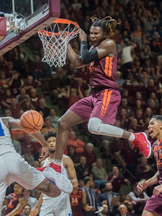 Virginia Tech forward Chris Clarke (15) makes a dunk over Duke forward Wendell Carter Jr (34) during the second half of an NCAA college basketball game Monday, Feb. 26, 2018, in Blacksburg, Va. Va Tech won 64-63. (AP Photo/Don Petersen)