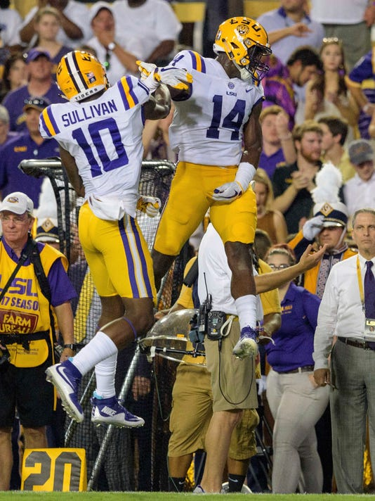 LSU wide receiver Stephen Sullivan (10) celebrates his touchdown with wide receiver Drake Davis (14) against Syracuse in the first half of an NCAA college football game in Baton Rouge, La., Sunday, Sept. 24, 2017. (AP Photo/Matthew Hinton)