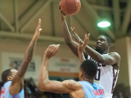 UMES guard Travis Trim (10) takes a shot against Del State at the W.P. Hytche Athletic Center on Saturday afternoon.