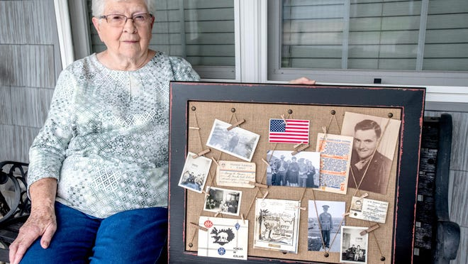 """Lois Lauderback of Washington poses with a scrapboard of family photos and memorabilia about her brother George """"Bud"""" Reeser, a U.S. Marine who was killed in action in the Battle of Tarawa in 1943. Lauderback was only 7 years old at the time. Reeser's remains were recently recovered from the South Pacific island and he will be laid to rest with full military honors Saturday at the family plot in Deer Creek."""