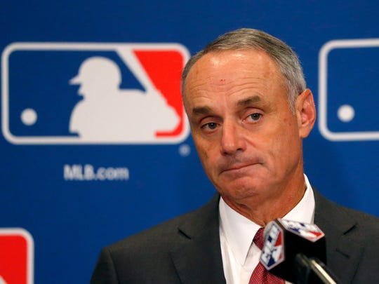 Commissioner Rob Manfred listens to a question following the two-day meeting of Major League Baseball owners, Aug. 17, 2017 in Chicago.