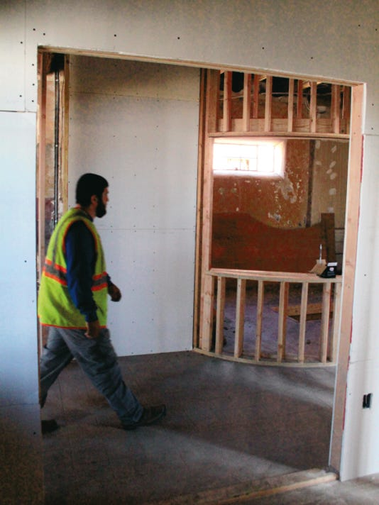 Bryan Betts — Daily News A construction worker walked from what will be the gift shop toward the exhibit area of the Tularosa Basin Historical Society's new museum inside the Plaza building Tuesday. The society is looking for someone to come in to manage the gift shop and sell southwestern arts and gifts that relate to the museum's regional theme.