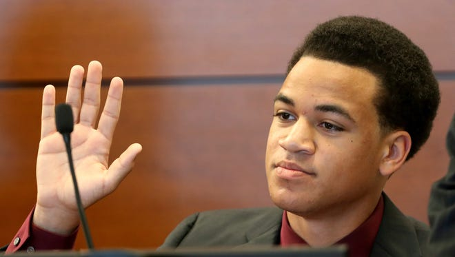 Zachary Cruz testifies during his hearing at the Broward County Courthouse in Fort Lauderdale, Fla., Friday, May 11, 2018. A judge granted Cruz permission to move to Virginia to participate in a program that helps people adjust after prison or substance abuse treatment. The judge had to approve the move because Cruz is on probation for trespassing at Marjory Stoneman Douglas High School. His brother Nikolas Cruz is accused of killing 17 people there in the Valentine's Day shooting rampage.