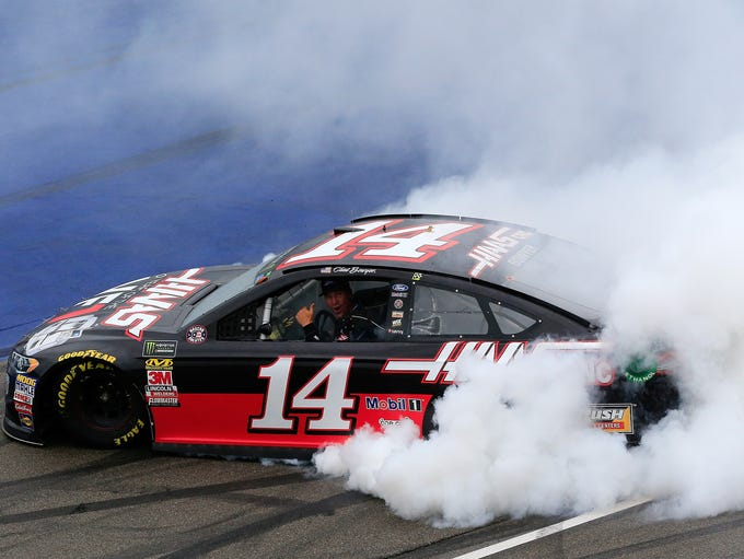 Clint Bowyer, driver of the No. 14 Ford, celebrates