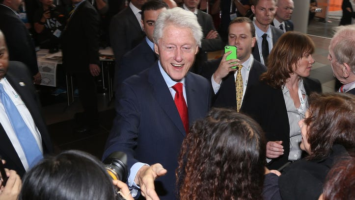 MELBOURNE, AUSTRALIA - JULY 23:  Former U.S. President Bill Clinton greets conference attendees as he leaves the 20th International AIDS Conference at The Melbourne Convention and Exhibition Centre on July 23, 2014 in Melbourne, Australia. Several researchers, activists and health workers due to attend the conference were killed enroute in the Malaysian Airlines plane MH17 shot down over Eastern Ukraine.