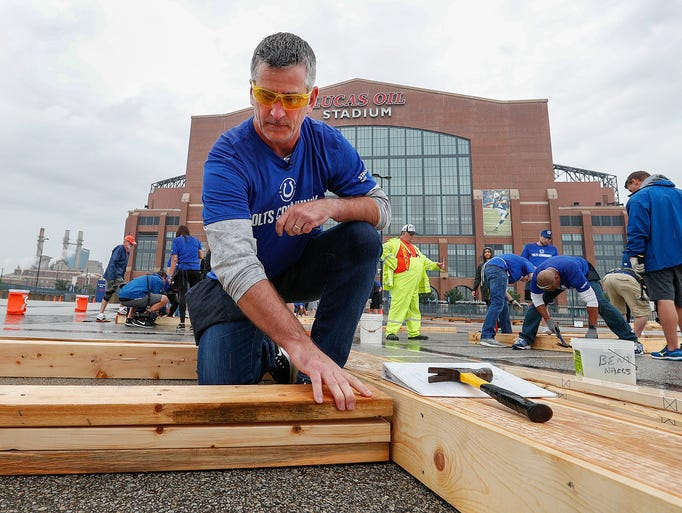 Colts head coach Frank Reich helps build the walls