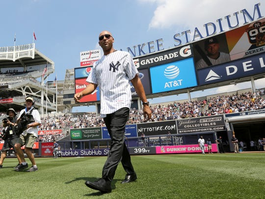 Former New York Yankees shortstop Derek Jeter walks