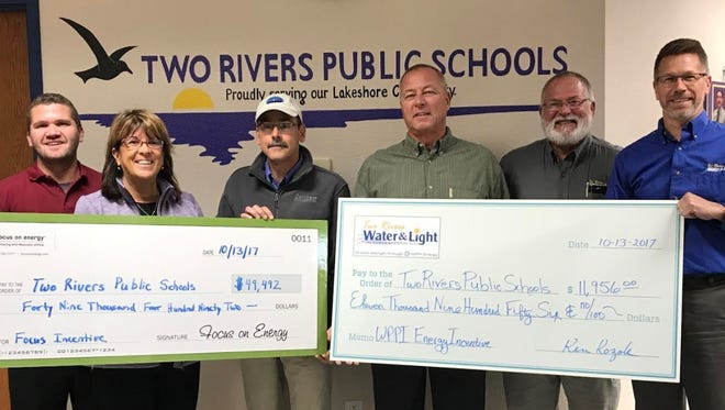 Two Rivers Public School District received two rebate checks totaling $61,448 on Oct. 13, one for $49,494 from Focus on Energy and one for $11,956 from Wisconsin Public Power Inc. Pictured: Joe Kottwitz, energy adviser, Focus on Energy; Lisa Quistorf, Two Rivers Public School District administrator; Jaimie Salta, Two Rivers Board of Education vice president; Bob Bauknecht, director of maintenance for Two Rivers Public School District; Ken Kozak, electric utility director; and Frank Barth, energy services representative.