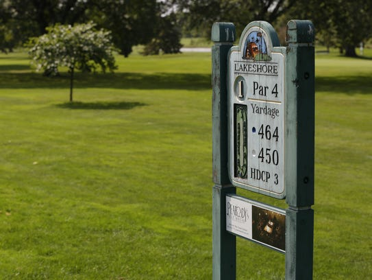 A sign indicates par for the first hole Sept. 15, 2017,
