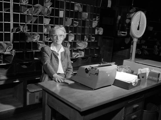 Geraldine T. Johnson, postmaster at Ash Grove in 1958
