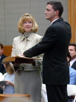 David Bunning is sworn in as a federal judge March 27, 2002. His wife stands at his side.