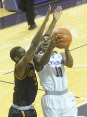 ACU's Isaiah Tripp, right, drives to the basket against a Howard Payne defender. ACU beat the Yellow Jackets 71-55 Sunday, Nov. 27, 2016 at Moody Coliseum.