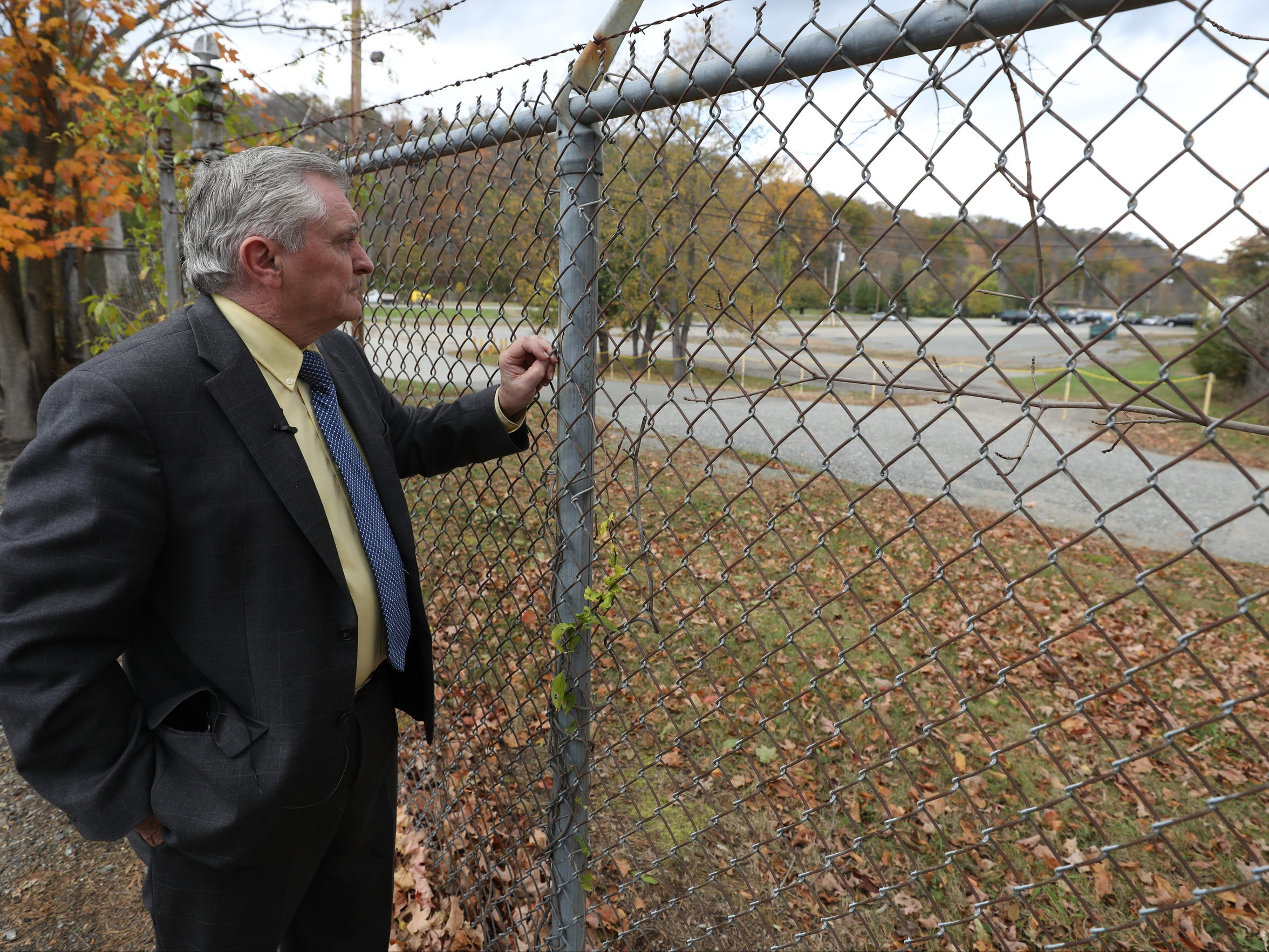 Former Pompton Lakes Mayor John Sinsimer looks toward DuPont's former munitions site in the borough. In 1988 he was credited with broadening an investigation of groundwater contamination on site to the adjacent neighborhood.