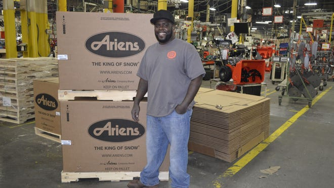 Jason Wright of Green Bay stands inside an Ariens Co. assembly plant in Brillion. Wright, has been employed at Ariens for a year after previously working for the company in a prison work-release program.