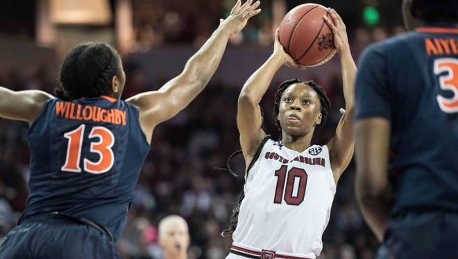South Carolina guard Bianca Jackson (10) attempts a shot against Virginia guard Jocelyn Willoughby (13) during the first half of a second-round game of the NCAA women's college basketball tournament, Sunday, March 18, 2018, in Columbia, S.C. (AP Photo/Sean Rayford)