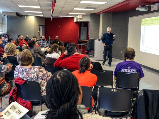 Terry Scott, Director of the Center for Instructional and Behavioral Research in School at the University of Louisville, speaks to educators gathered at Waggener High School, on restorative behavior.